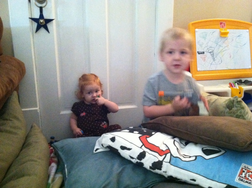 """Protecting his sister from the """"awee-ins""""."""